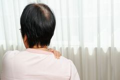 Neck and shoulder pain, old woman suffering from neck and shoulder injury, health problem concept stock photo