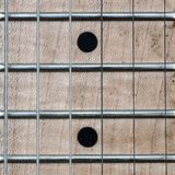 Neck and snares of electric guitar in closeup. With black dots Stock Photos