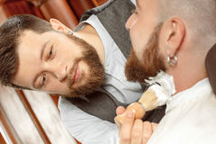 Neck soaping and shaving in barber shop Royalty Free Stock Image
