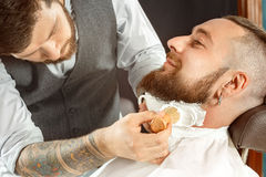 Neck soaping and shaving in barber shop Royalty Free Stock Photography