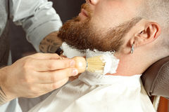 Neck soaping and shaving in barber shop Royalty Free Stock Images