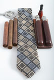 Neck tie with cigars and accessories. Cigar cutter sizers leather cigar case Royalty Free Stock Photography