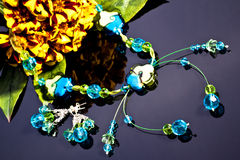 Neckalce and flower Stock Images