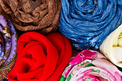 Neckerchiefs. Varicolored  scarves and stoles are folded in a circle, view from above Royalty Free Stock Photography