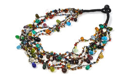 Necklace. From multicolor stones, isolated on white Stock Images