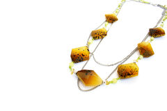 Necklace. Yellow necklace isolated on white background Royalty Free Stock Photography