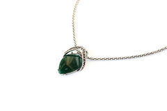 Necklace. With green stone   on white background Royalty Free Stock Image
