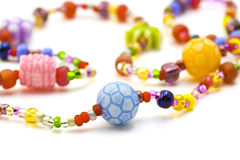 Necklace. Children's necklace of beads and plastic Royalty Free Stock Photo