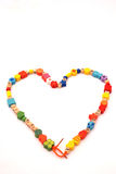 Necklace. A colorful necklace with wooden beads for kids in a heart shape. Image isolated on white studio background Stock Photos