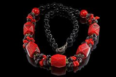 Necklace of agate, red coral and garnet Royalty Free Stock Image