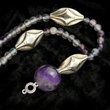 Necklace with amethyst and fluorite beads Royalty Free Stock Image