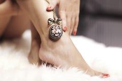 Necklace And Leg Stock Photos