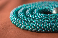 Necklace from beads of color aquamarine Stock Photos