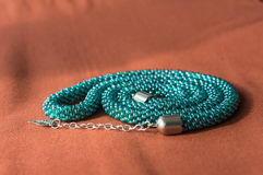 Necklace from beads of color aquamarine Royalty Free Stock Photography
