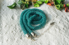 Necklace from beads of color aquamarine Stock Photography