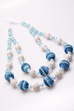 Necklace of beads knitted Stock Photos
