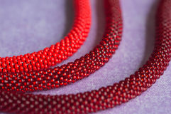 Necklace from beads of three shades red Royalty Free Stock Images