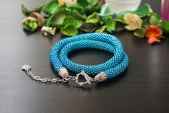 Necklace from beads of turquoise color on a wooden background Royalty Free Stock Photos