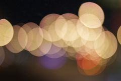 Abstract warm orange bokeh background, blurred big city royalty free stock photo