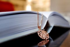 Necklace on the book Royalty Free Stock Image