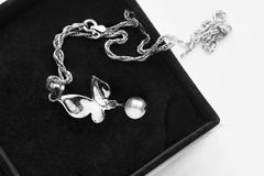 cc6d4732a7a9a6 Silver butterfly pendant with white pearl in black jewel box stock