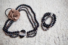 Necklace and bracelet made of artificial black pearls Royalty Free Stock Images