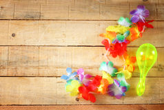 Necklace of bright colorful flowers lei on wood background Royalty Free Stock Photos