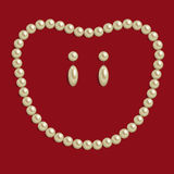 Necklace of brilliant pearls on red background. Necklace of brilliant pearls of cream colour with the earrings on dark red background Stock Photos