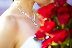 Necklace and bunch of red roses Stock Images