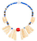 Necklace from carved bone and blue glass beads Stock Photo