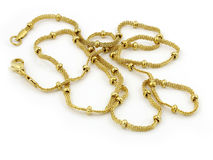 Necklace - Chain - Gold or silver. One color background royalty free stock images