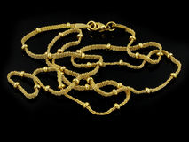Necklace - Chain - Gold or silver. One color background royalty free stock image