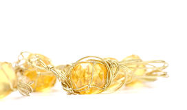 Necklace with cheap plastic gems with golden colored rope Royalty Free Stock Photo
