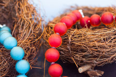 Necklace. Close up of red pearls necklace on nest stock images