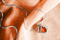 Necklace on cloth Royalty Free Stock Photos