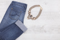 Necklace and denim jeans Royalty Free Stock Photo