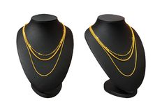 Necklace display stand with gold necklace isolated on white background. Part of top blank mannequin.  Clipping path stock photography