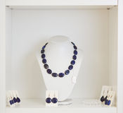 Necklace and earrings on display Stock Photo