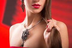 Necklace on female neck. girl holding hands. sexy red lips. Royalty Free Stock Photography
