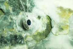 Necklace upon a fossil oyster shell Stock Image