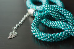 Necklace fragment from beads of color aquamarine Stock Photo