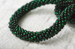 Necklace fragment from green beads Stock Photos