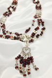 Necklace with a garnet Royalty Free Stock Image