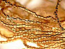 Necklace with gold beads Royalty Free Stock Photo