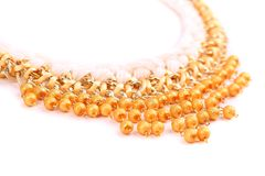 Necklace of gold pearls on a white bacground Stock Images