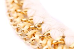 Necklace of gold and silk thread. Royalty Free Stock Photography