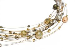 Necklace from gold and silver pearls. On white background Royalty Free Stock Photo