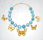 Necklace of golden butterflies Royalty Free Stock Photo