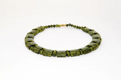 A necklace of green jasper on a white background.  Stock Image