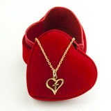 Necklace and heart shaped box. Necklace and heart shaped red box Stock Photography
